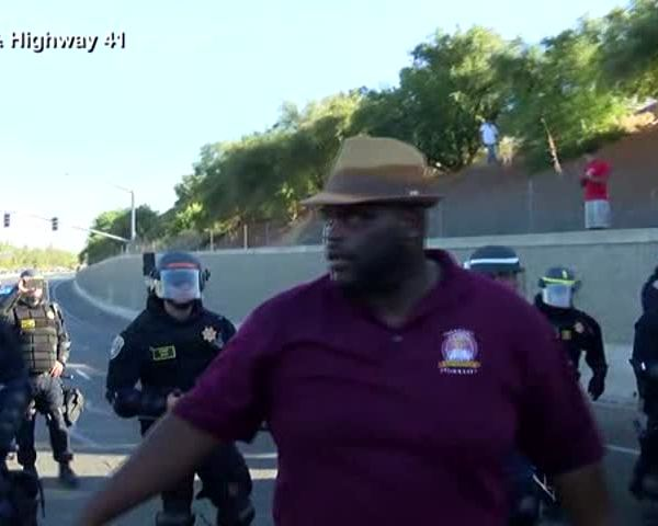 Pastor Turns Back Protesters On Highway Onramp_89463808-159532
