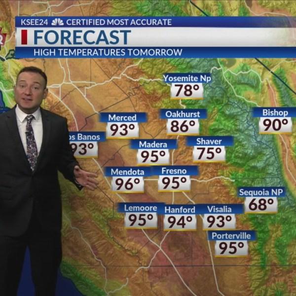 Meteorologist Justin Sacher presenting the forecast