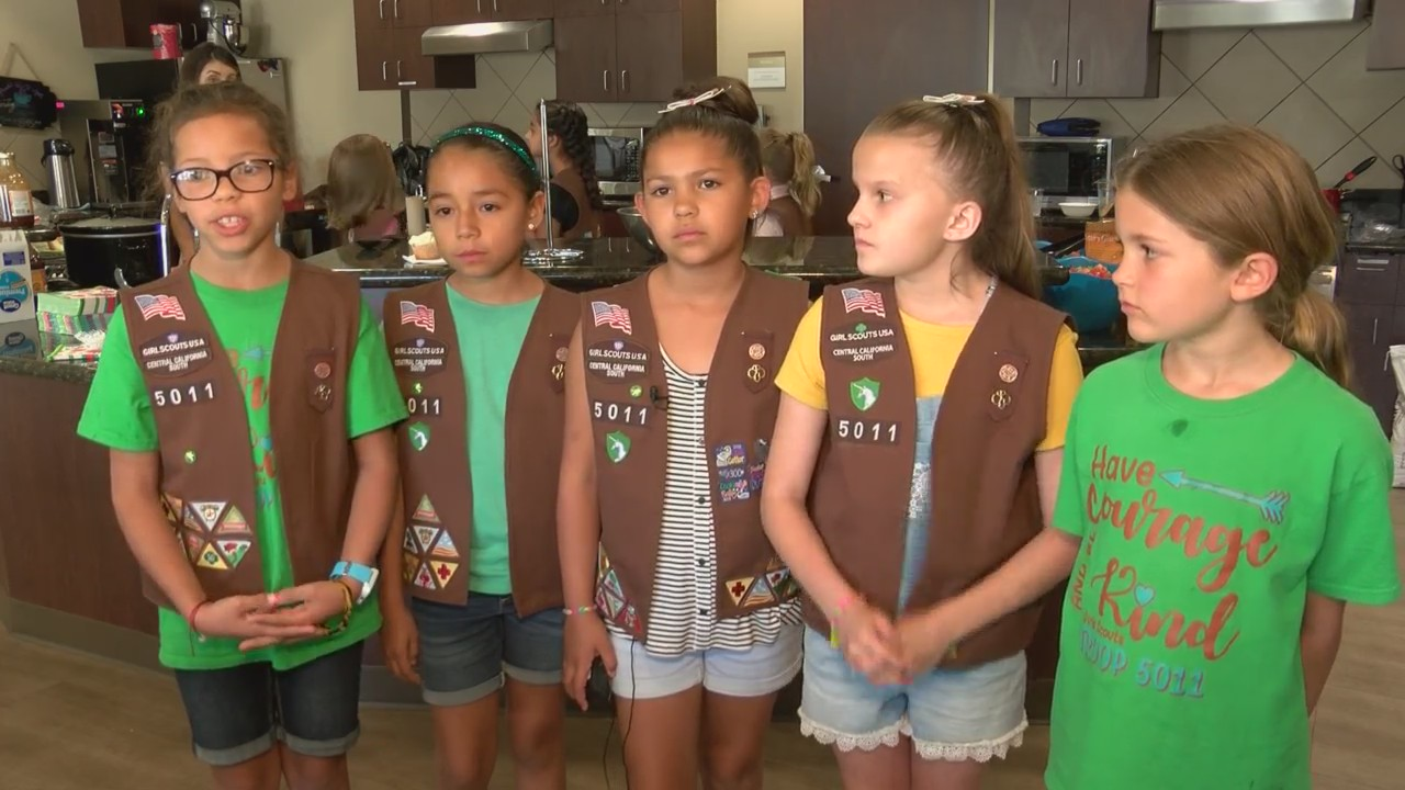 Fresno Girl Scouts serve dinner to guests staying at Terry's House