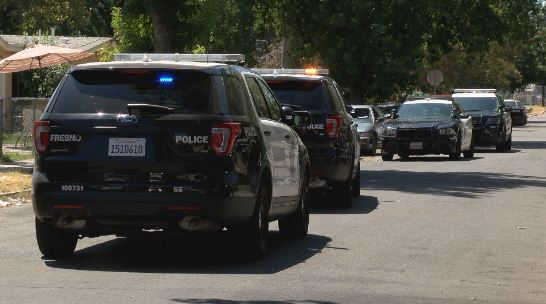 Fresno Police respond to armed disturbance, sending 2 officers to the hospital