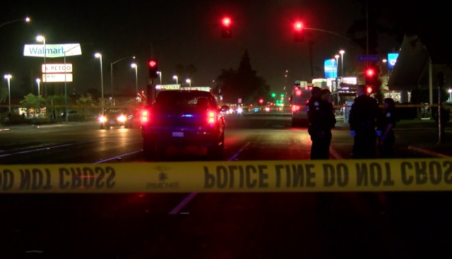 Woman struck and killed after crawling into traffic, police say