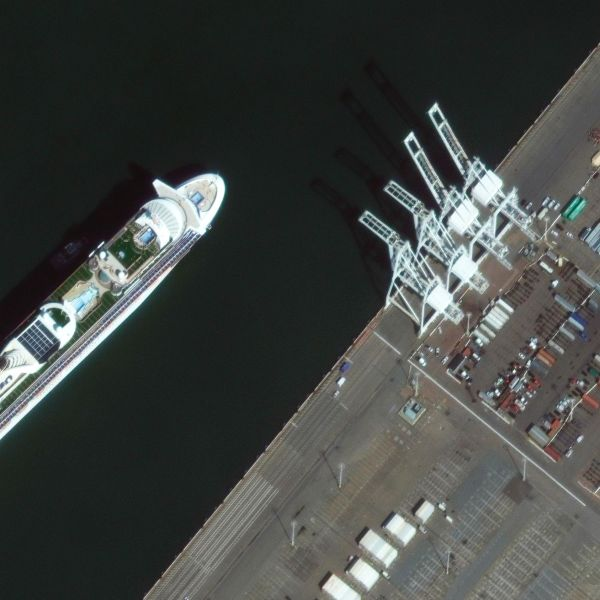 In this satellite image provided by Maxar Technologies, the Grand Princess cruise ship is seen as it was preparing to dock at the Port of Oakland in Oakland, Calif., Monday, March 9, 2020. The cruise ship forced to idle for days off the coast of California because of a cluster of novel coronavirus cases aboard arrived in port Monday as state and U.S. officials prepared to transfer its thousands of passengers to military bases for quarantine or return them to their home countries. (Satellite image ©2020 Maxar Technologies via AP)