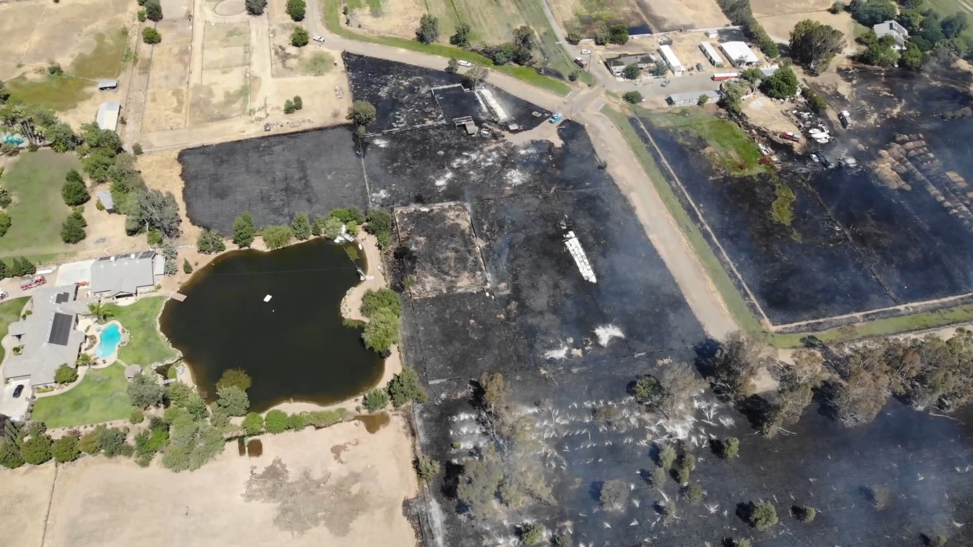 Barn and vacant mobile home destroyed in a large grass fire outside Clovis
