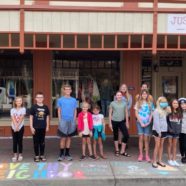Students chalk messages of support for Clovis business struck by hate crime