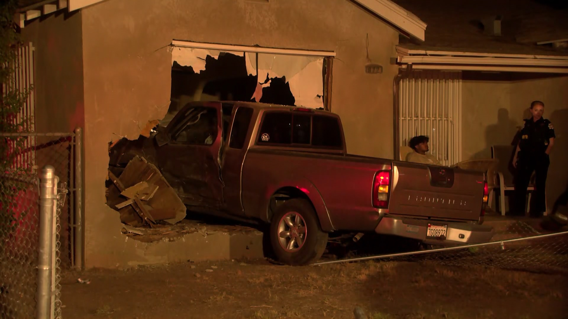 Truck crashes into Fresno house, homeowner escapes with minor injuries