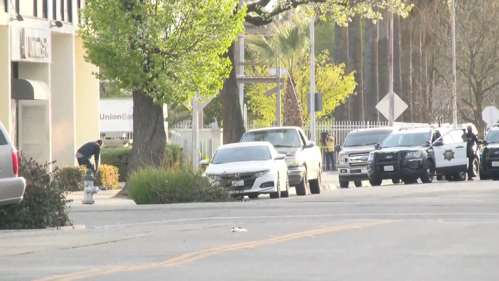 Shooting leads to stand-off outside Fresno bank, police say