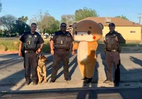 Bearsun stops in Coalinga for photo with police officers