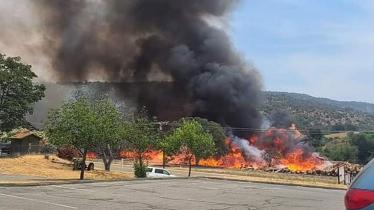 Crews battling fire at Auberry lumber mill