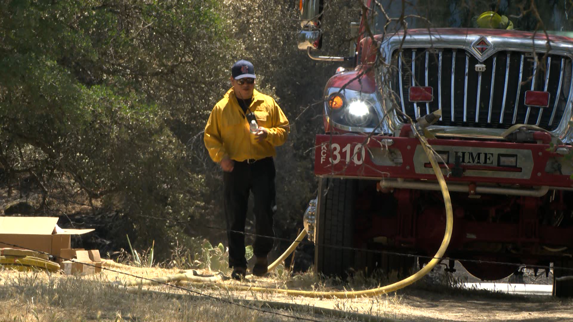 Fire crews continue to battle Smalley Fire in extreme heat, expect full containment Thursday