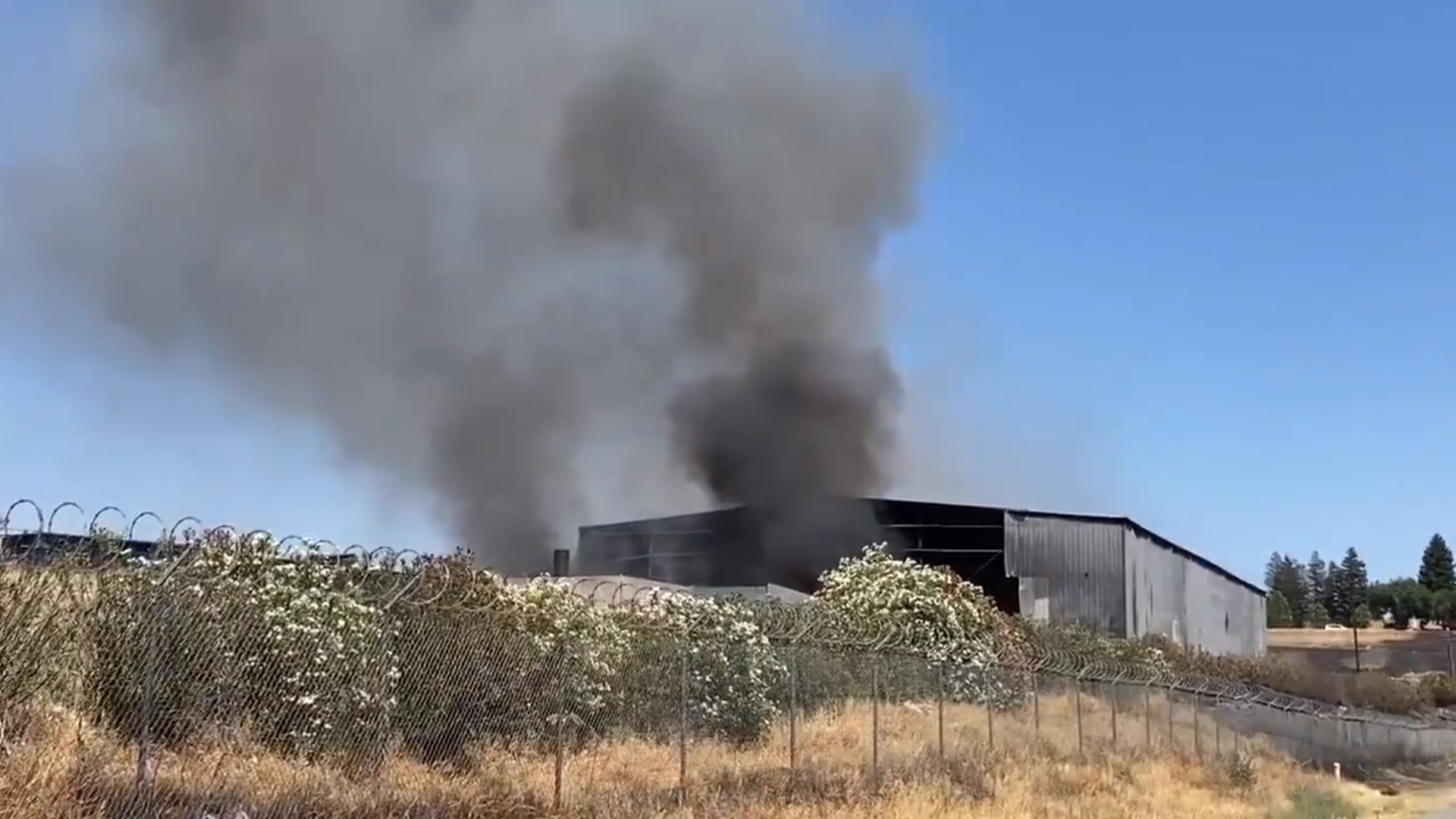 Northeast Fresno warehouse on fire, crews working to control flames