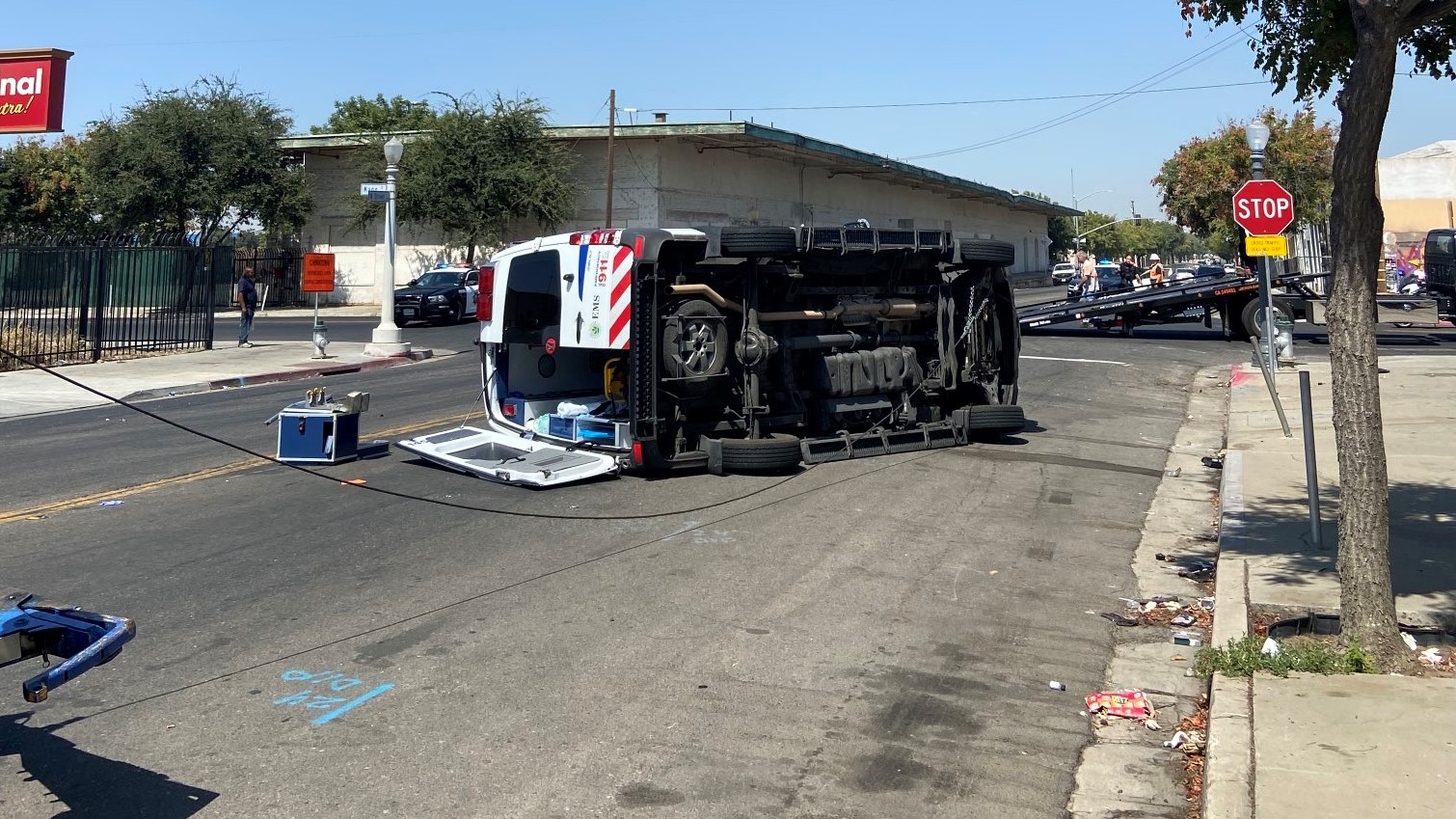 Ambulance on its side after crash in Downtown Fresno